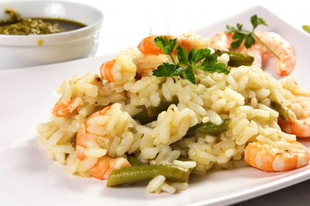 rice with shrimp and green beans on the dish on the table Stock Photo