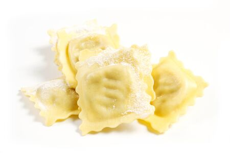 homemade ravioli on a white background with utensil Stock Photo
