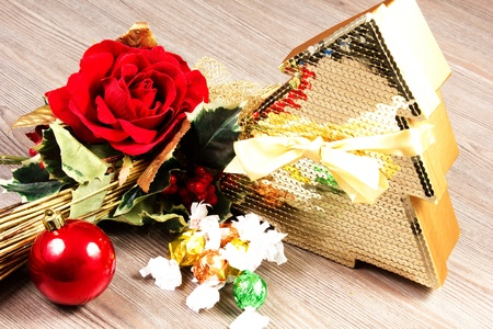 chocolate box on a table wood with rose an christmas decorations Stock Photo