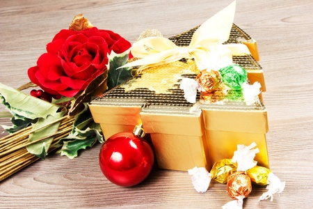 chocolate box on a table wood with rose an christmas decorations photo