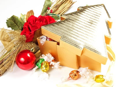 chocolate box on a white background with rose an christmas decorations Stock Photo