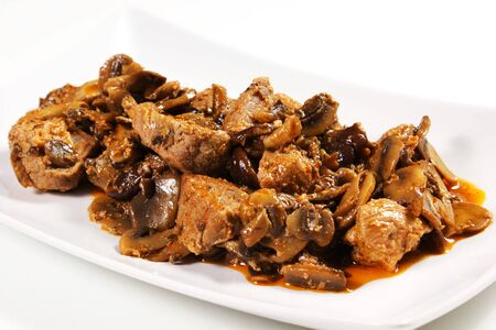 beef stew with mushrooms on a white background