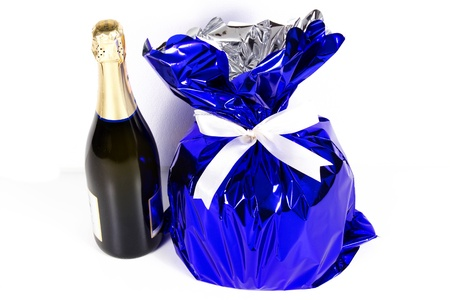 panettone and champagne on a white background