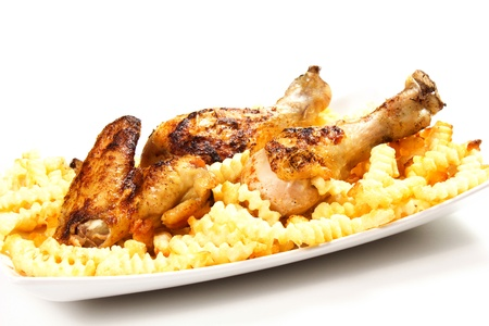 baked chicken with french fries on a white background Stock Photo