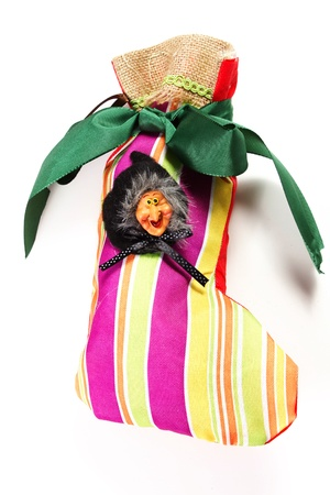 Epiphany sock decorated with old woman riding broom  In Italian tradition an old woman