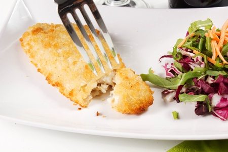 breaded fish fingers and salad photo