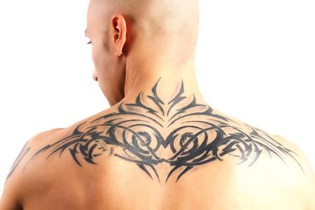 tatouage: homme tatou� qui fait salle de sport sur un fond blanc