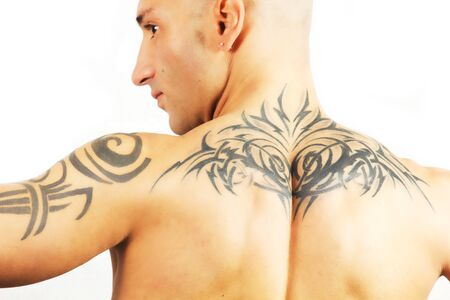 tattooed man who does gym on a white background photo