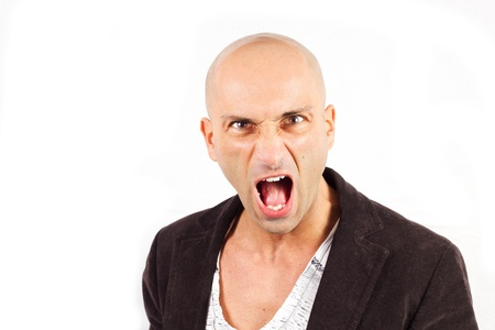 angry man screaming on a white background photo