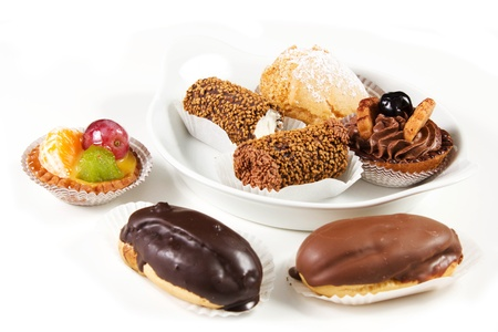 pastries with chocolate  cream and pastries with fruits on a white background photo