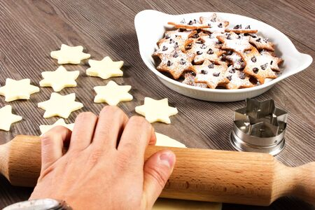 christmas star cookies  on the table with rolling pin Stock Photo - 17720489