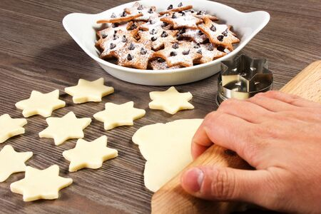 christmas star cookies  on the table with rolling pin Stock Photo - 17716271