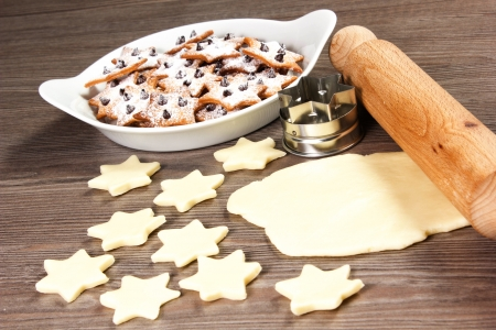 christmas star cookies  on the table with rolling pin Stock Photo - 17716272