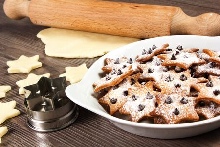 christmas star cookies  on the table with rolling pin Stock Photo - 17720488