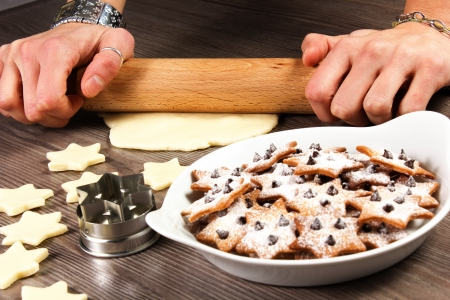 christmas star cookies  on the table with rolling pin Stock Photo - 17720487