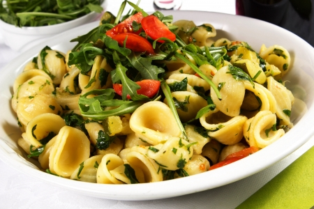 orecchiette, with rucola salad and tomatoes on the white with wine