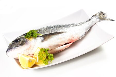sea bream on a white background with lemon Stock Photo - 17720495