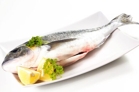 sea bream on a white background with lemon Stock Photo - 17720500