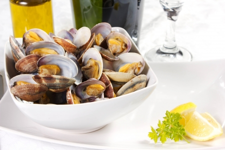 clams  cooked in a dish with lemon and parsley Stock Photo - 17720506