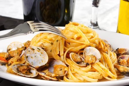 Spaghetti with clams and tomato sauce photo