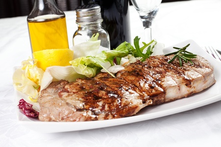 bovine meat cooked on the griddle in the dish on the table with oil and salt Stock Photo - 17875215