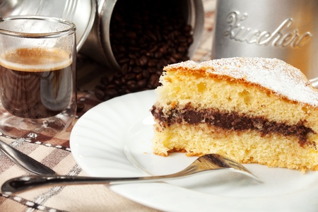 ailment: breakfast on the table with coffee, chocolate cake, orange juice and sugar