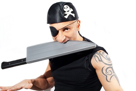 Young man in a pirate costume with pistol  Isolated on white photo