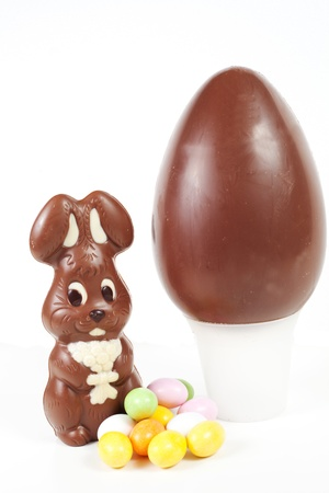Easter bunny made of chocolate with easter egg isolated on a white background photo