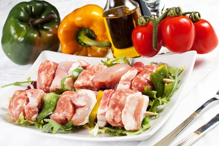 meat pieces on wood sticks with vegetables without shadow Stock Photo - 18810163