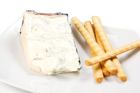 piece of Italian gorgonzola cheese and bread stick photo