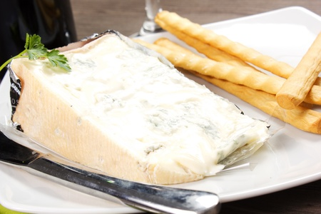 piece of Italian gorgonzola cheese and bread stick Stock Photo - 19124862