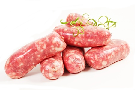 llonganissa: a pile of pork meat sausages isolated on a white background