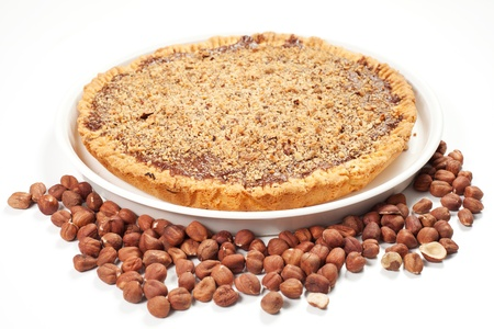 hazelnut cake with hazelnuts on the table photo