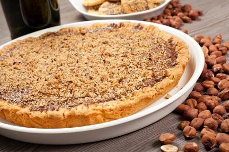 hazelnut cake with hazelnuts on the table photo