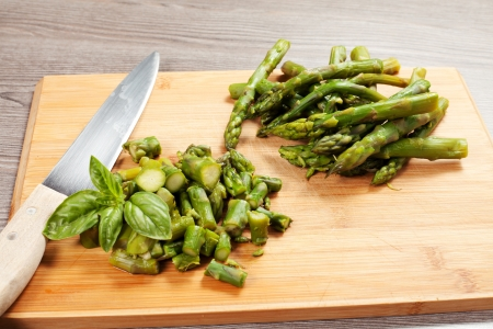 fresh green asparagus spears, old wood table background Stock Photo