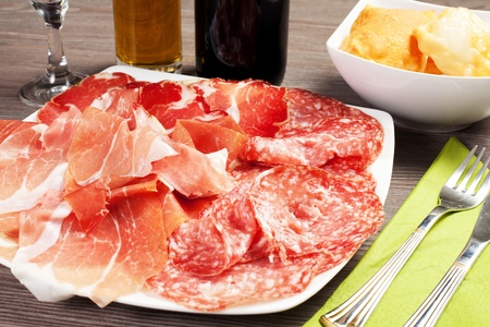 pancakes with ham and meat products on a wood table photo