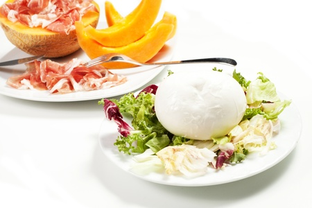 mozzarella and salad , melon and ham on the white background