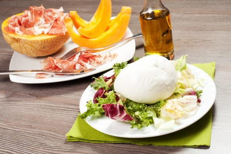 mozzarella and salad , melon and ham on the wood table Stock Photo