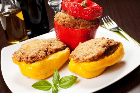 stuffed peppers with basil on the dish on the white background