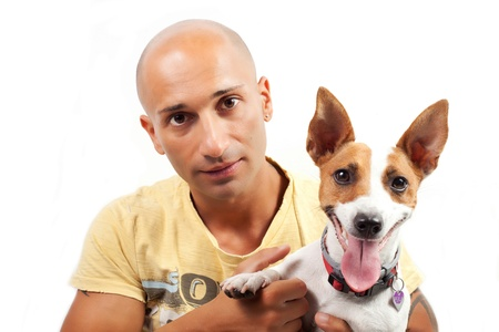 caucasian boy and jack russel dog on the white background