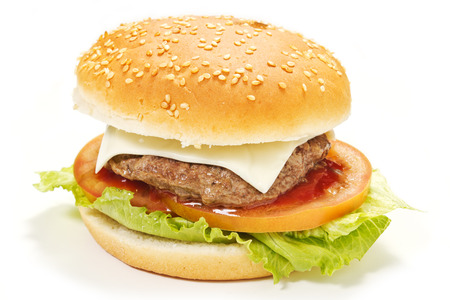 Big hamburger on white background with tomatoes, salad, cheese photo