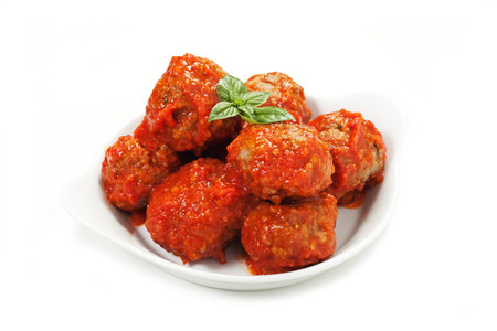 meatballs under meat sauce on white background Stock Photo