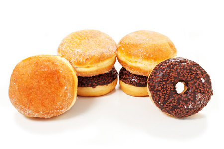 cream and chocolate  doughnuts on a white background photo