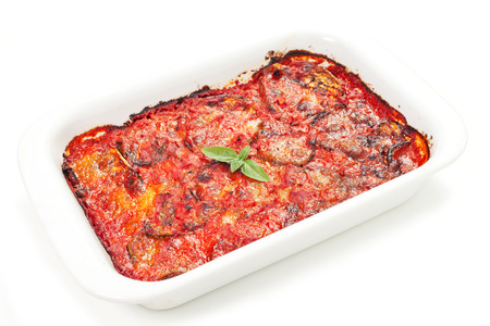 parmigiana eggplant with fresh ingredient on a white background