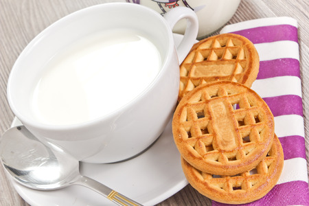 breakfast with milk and biscuits on the wood table photo