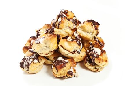 mass storage: pastries on the white background  Bignè Stock Photo