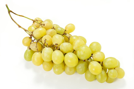 Fresh green grapes with leaves  Isolated on white photo