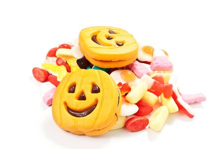 halloween biscuits and candy on a white background photo