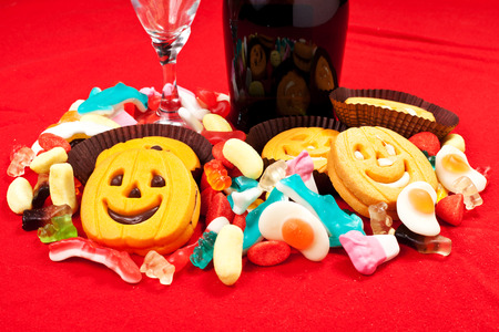 halloween biscuits and candy on a red tablecloth photo