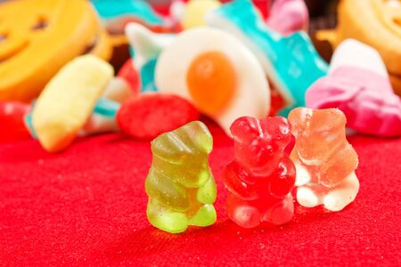 jelly bears on a red tablecloth photo